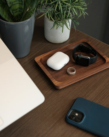 office flat lay on wooden desk with catch tray