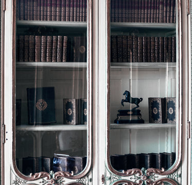 old books in an antique cabinet