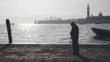old man thinking by the harbor