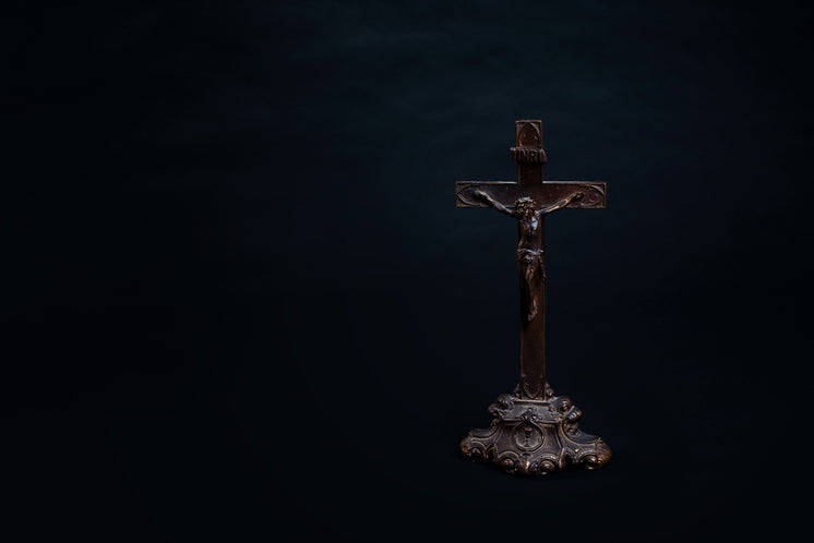 Old Wooden Cross With Carved Figure And Ornate Stand