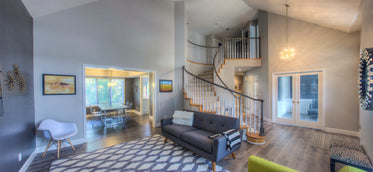 open plan home with spiral staircase