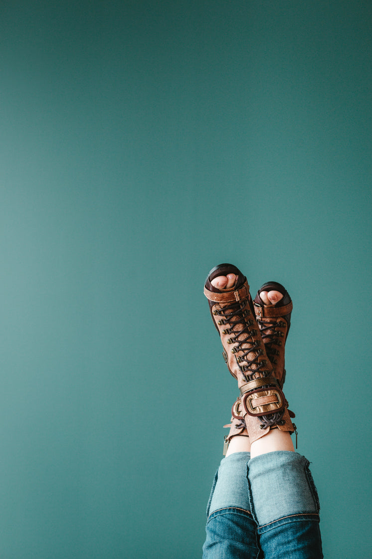 Open Toe Boots Against A Blue Background