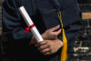 outside holding graduation cap and diploma
