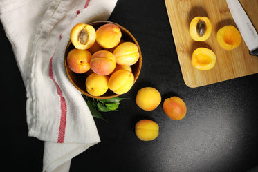 Browse Free HD Images of Overhead Shot Of Fresh Apricots Being Halved And Pitted