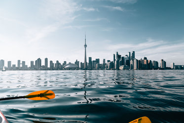 paddling by city skyline