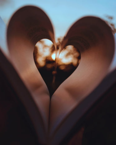 pages of a book curled inwards to create a heart