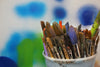 paint brushes in bucket