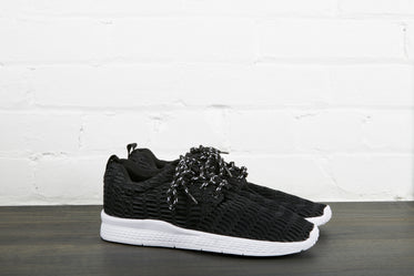 pair of black and white sneakers