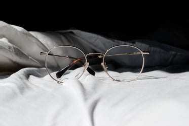 pair of glasses on a bed
