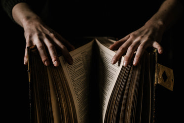 pair of hands hold a big book