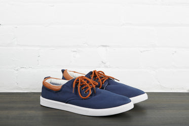 pair of navy blue skate shoes
