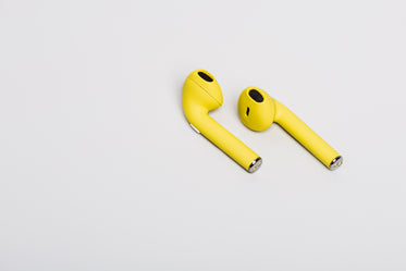 pair of yellow earbuds