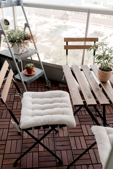 patio chairs and white cushions