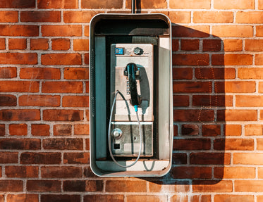 payphone on brick wall