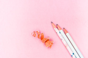 pencils and shavings on pink paper