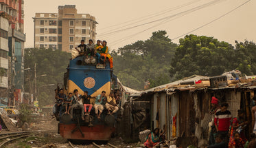 people finding a seat on a passing train