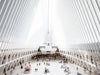 people pass by walking through the oculus in new york