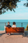 people sit on red bench and admire the view