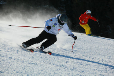 Person Cuts Through The Snow On Skis