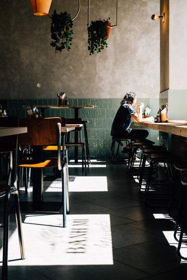 person enjoys lunch alone in a sunlit restaurant