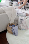 person folding laundered towels
