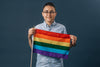 person holding a small pride flag