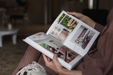 person holds open an interior design book
