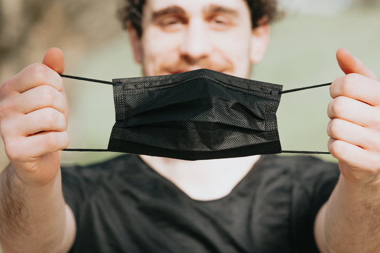 Person Holds Out A Black Facemask