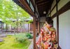 person in kimono faces away from the camera