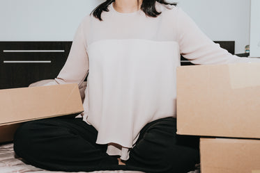 person sitting with large cardboard boxes