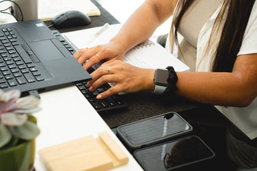 Person Typing Away With Both Hands On A Keyboard