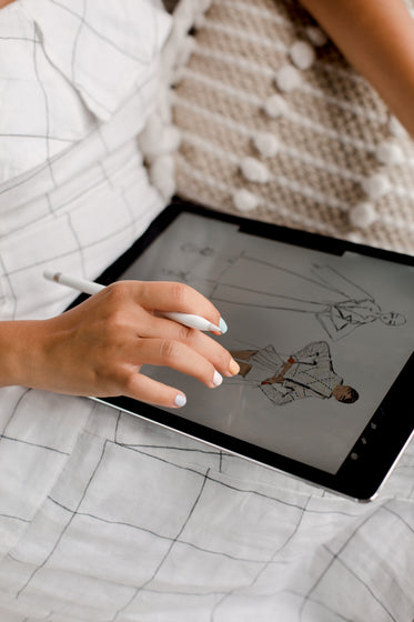 person working on fashion design on a tablet