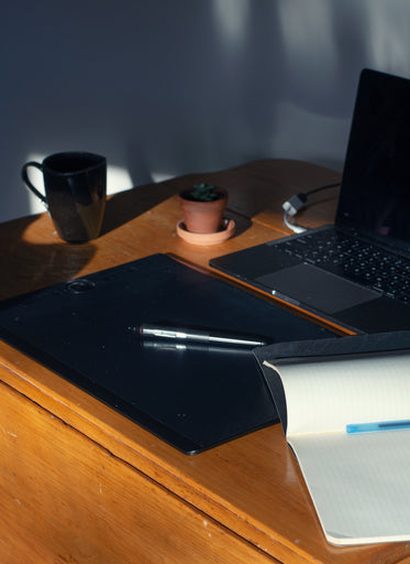 photo of a desk with a pen laying on a tablet