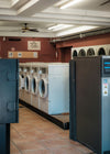 photo of a laundromat with red walls and white ceilings