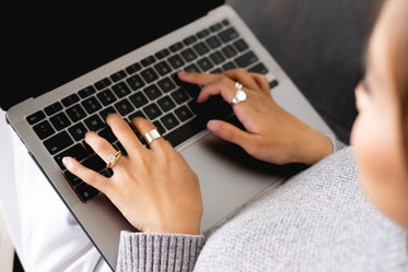photo of a person typing on their laptop