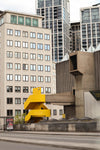 photo of city buildings and a yellow staircase