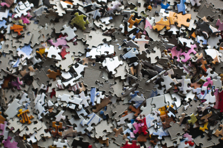 Piled Puzzle Pieces On Table