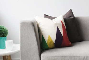 pillows on grey couch