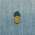 pineapple enamel pin on denim