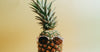 pineapple with pink rimmed sunglasses