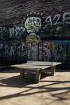 ping pong table in front of graffiti wall