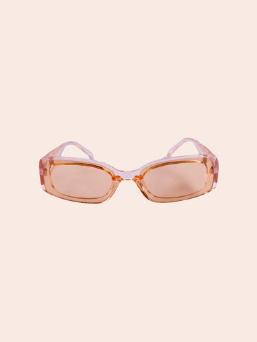 pink and beige sunglasses against soft white