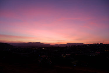 pink and purple sky after the sun has set on a town