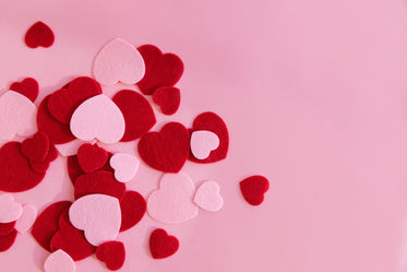 pink and red hearts on a pink surface