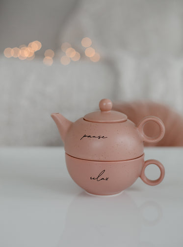 pink teapot with pause and relax written