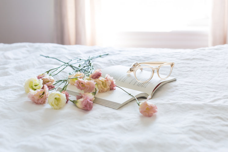 Pink Yellow Flowers On Bed