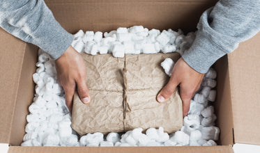 placing a package in packing material