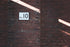 Browse Free HD Images of Platform 10 Sign On Brick Wall At Station