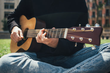 playing guitar in the park