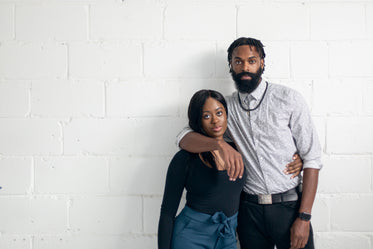 portrait of a man and women against a white wall